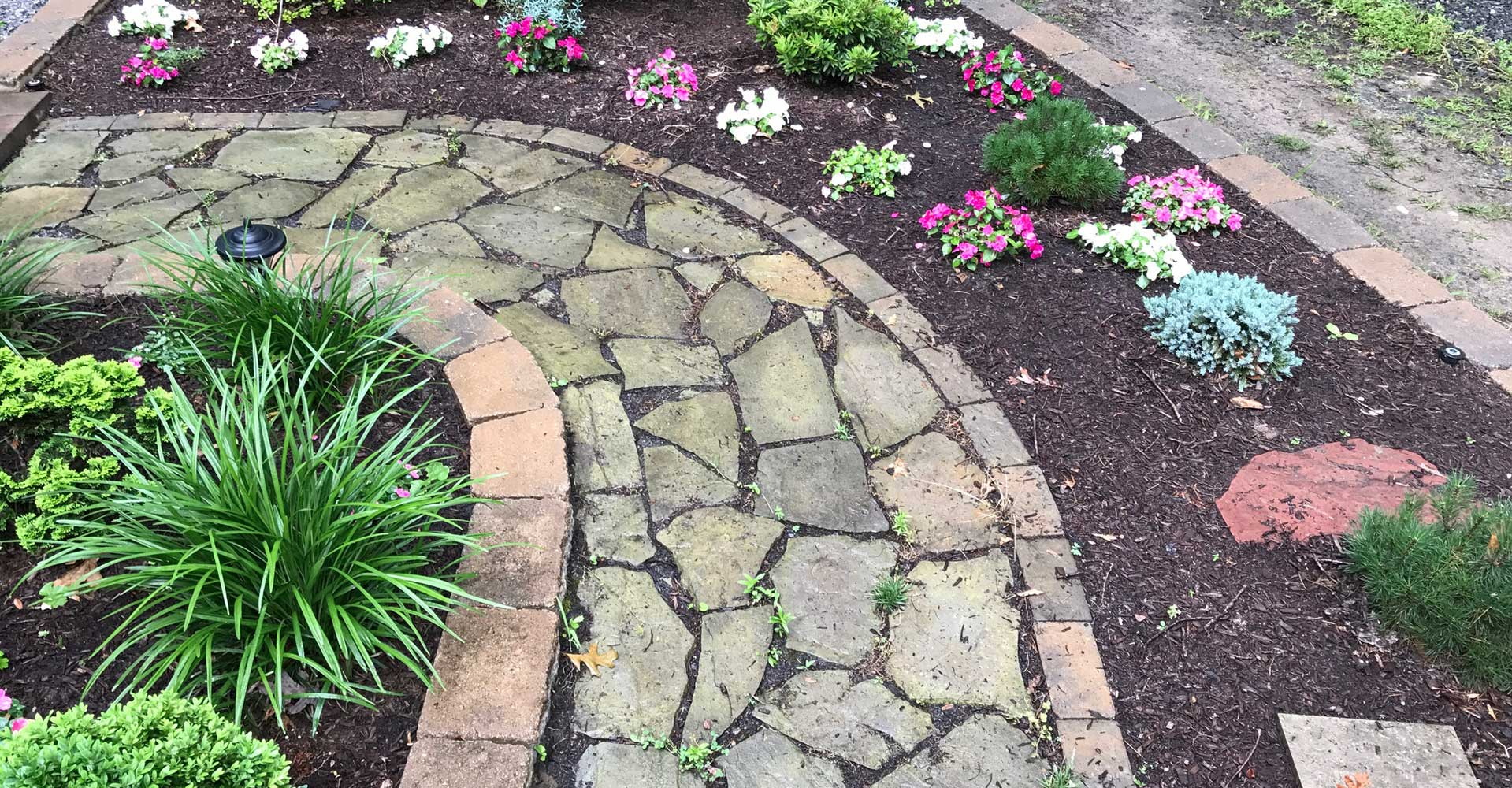 flower beds and slate walkways